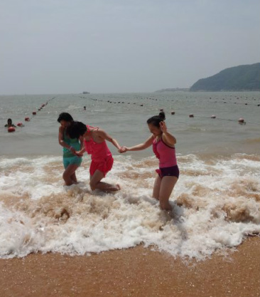 Chinese people playing with waves